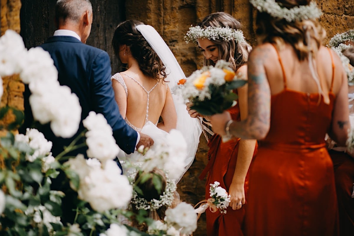 the bride walks down the isle for her wedding church ceremony documentary wedding photographer Nottingham