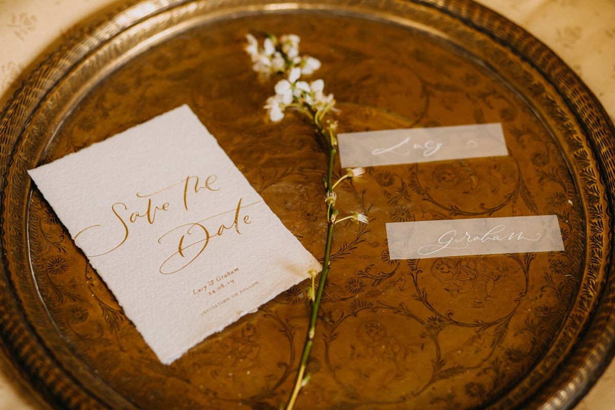 came-house-wedding-day-elegand-and-simple-stationery-presentes-on-a-gold-tray