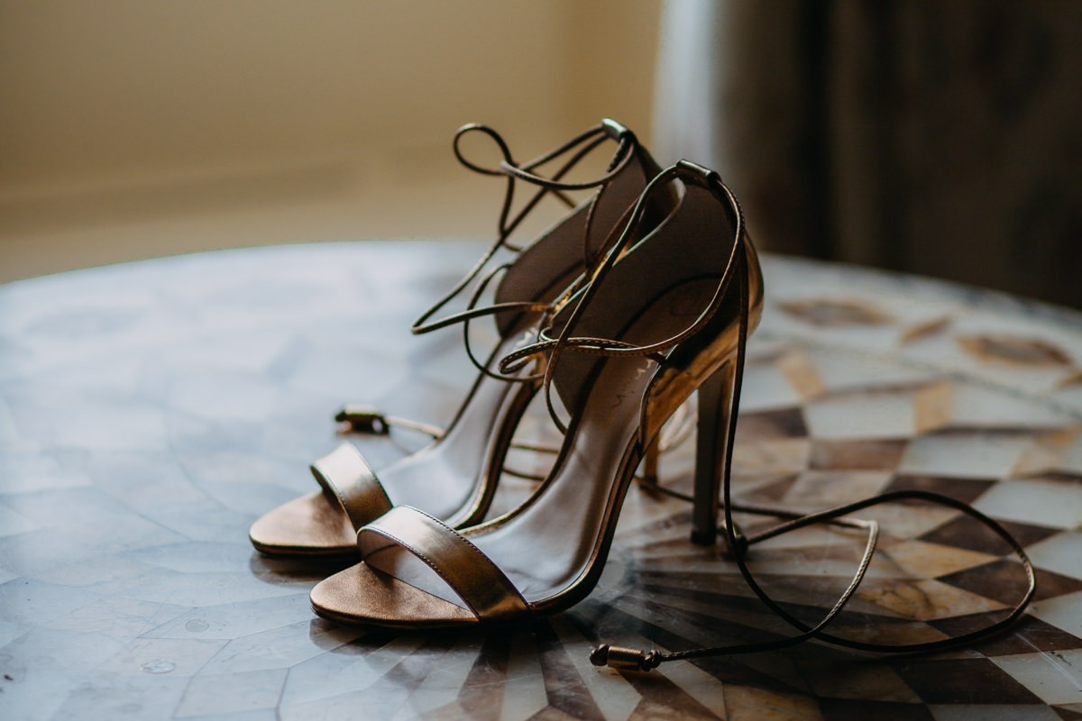 elegant-gold-wedding-shoes-wedding-detail-presented-in-the-getting-ready-t=r00m-at0came-house