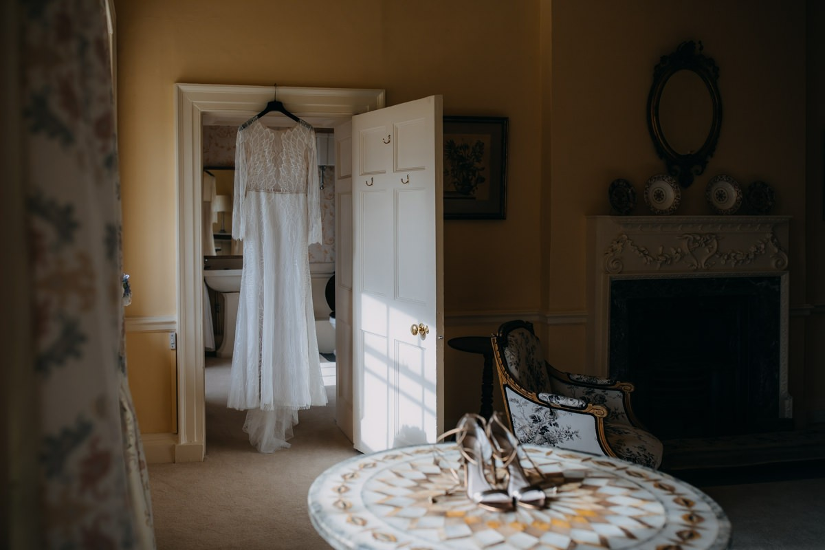 wedding-derss-is-hanging-in-the-getting-ready-room-at-came-house-dorset-with